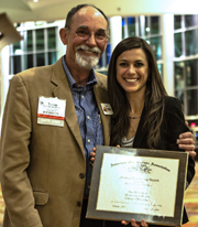 Prof. Tom Munyer shares a proud moment with Amy Kiskaddon.