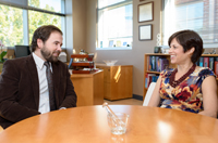 Dean Julie A. Johnson (right) appointed to the IOM, meets with Steven Smith, who was named an IOM Fellow in Pharmacy.