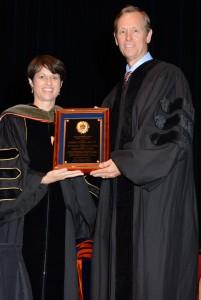 Dean Julie Johnson presents award to Mark Hobbs