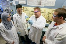 Medicinal chemists at the University of Florida recently discovered a series of organic compounds that can kill dangerous bacterial biofilms. Pictured l to r, Yasmeen Abouelhassan, Akash Basak, Dr. Rob Huigens and Chip Norwood