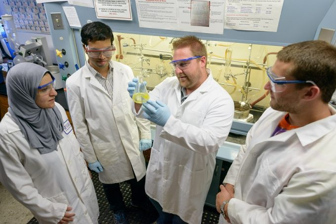 Medicinal Chemists Rob Huigens, Ph.D., with students
